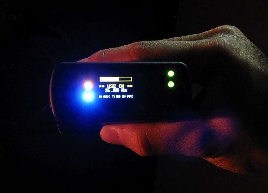 Handheld sensor with glowing colored lights